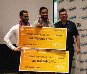 Kareem and Arif display their awards with sponsor representative