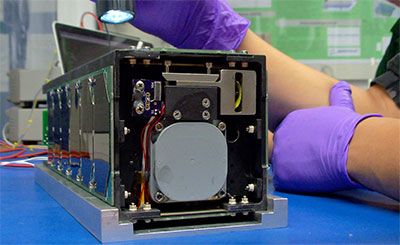 Photo of Cube Satellite on workbench during development